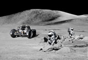 Image from the Apollo missions showing the lunar rover with astronauts investigating the moon surface. Click here to seem more lunar images.